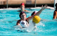 San Diego State water polo senior utility Emily Bennett defends a UC Irvine player during the Aztecs' series against the then-No. 4 Anteaters on Feb. 20 at the Aztec Aquaplex.