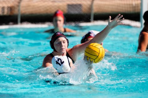 San Diego State water polo senior utility Emily Bennett defends a UC Irvine player during the Aztecs