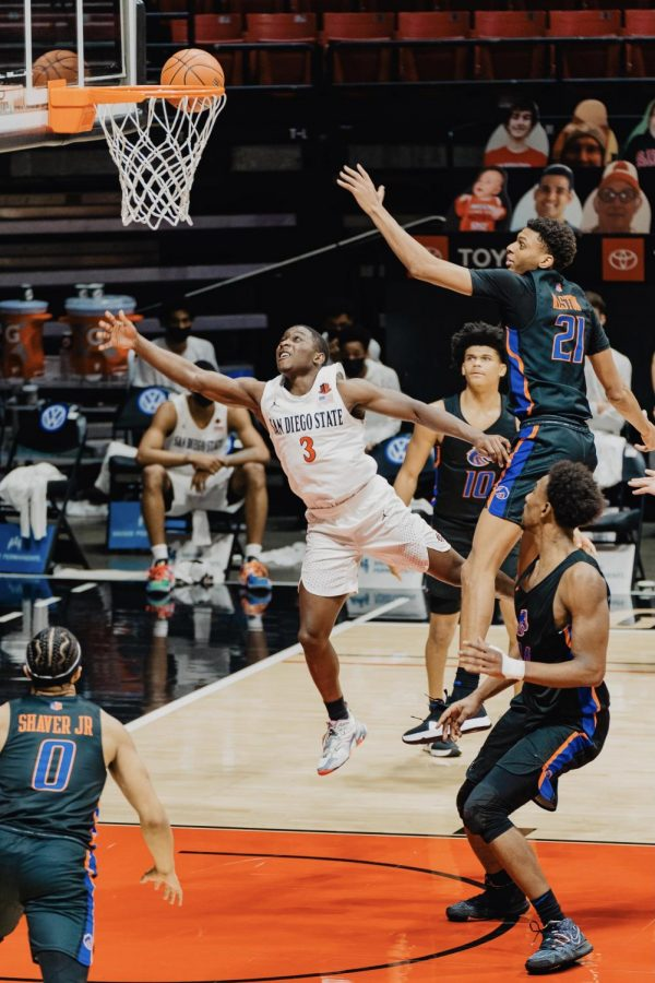 San Diego State men's basketball senior guard Terrell Gomez attempts a layup during the Aztecs' 78-66 overtime win over Boise State on Feb. 25, 2021 at Viejas Arena.