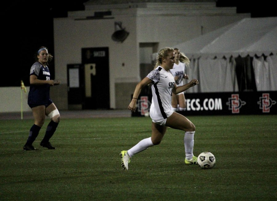 San Diego State womens soccer midfielder Malia Kaleiohi dribbles the ball upfield during the Aztecs 3-2 win over Nevada on March 5 at the SDSU Sports Deck.