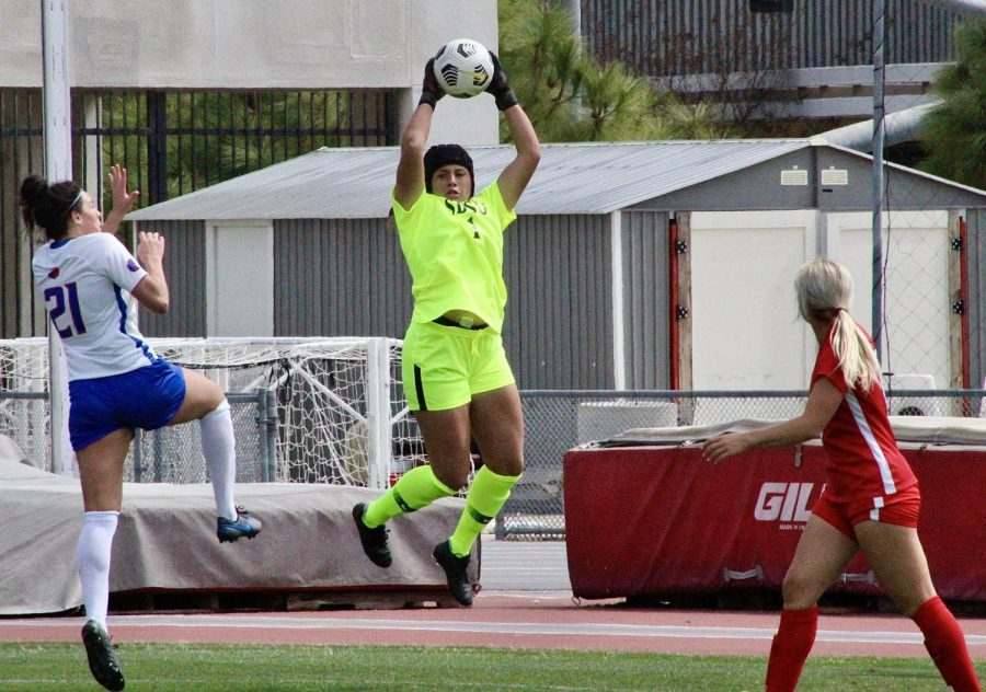 San Diego State women's soccer goalkeeper Alexa Madueno catches the ball during the Aztecs' 3-1 win over Boise State on March 7, 2021 at the SDSU Sports Deck.