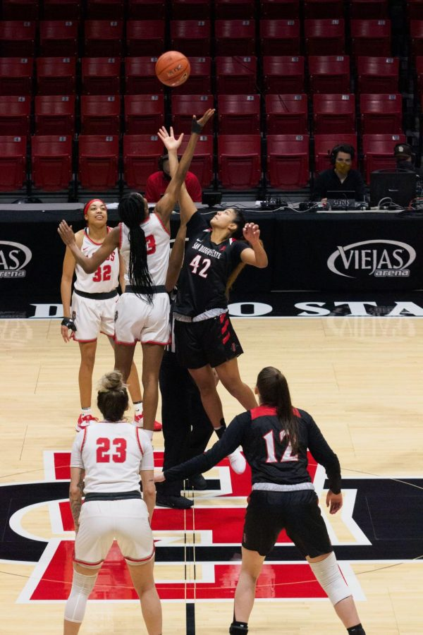 San Diego State women's basketball freshman forward Kim Villalobos jumps for the opening tip during the Aztecs' 65-48 loss to the Lobos on Feb. 5, 2021 at Viejas Arena.