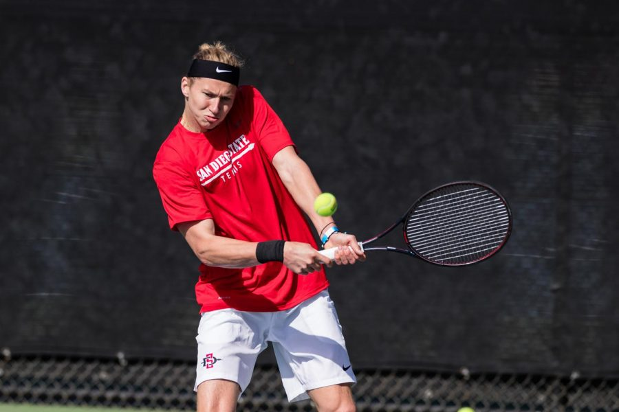 San Diego State men's tennis sophomore Johannes Seeman swings at a ball during the 2020-21 season.