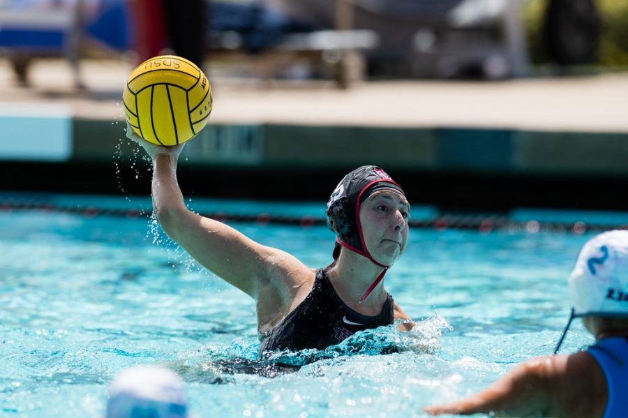 San Diego State water polo freshman utility player Laurene Padilla attempts a shot during the Aztecs' 11-4 win over No. 18 Loyola Marymount on March 20, 2021 at the Aztec Aquaplex.