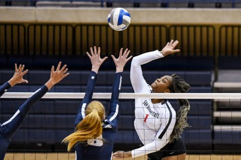 San Diego State volleyball sophomore outside hitter Nya Blair spikes the ball during the Aztecs