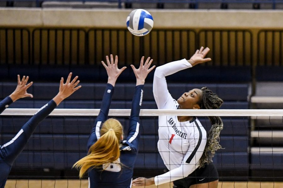 San Diego State volleyball sophomore outside hitter Nya Blair spikes the ball during the Aztecs' 3-2 win over Utah State on March 12, 2021 at Jenny Craig Pavilion on the campus of the University of San Diego.