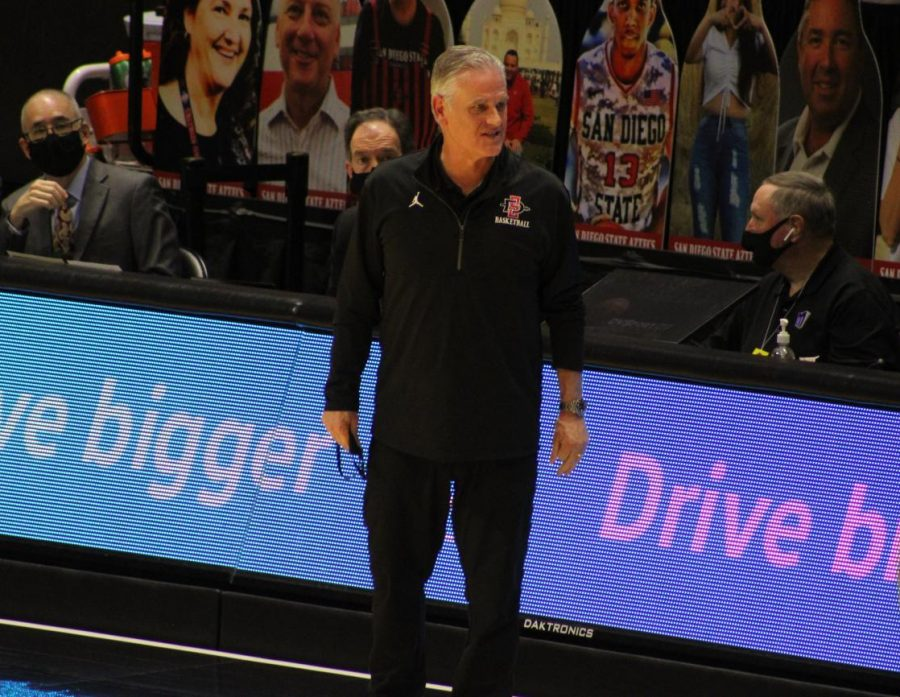 San Diego State men's basketball head coach Brian Dutcher gives instructions to a player during the Aztecs' 69-67 win over Nevada on Jan. 9, 2021 at Viejas Arena.