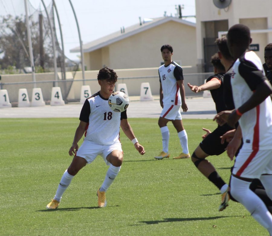 San Diego State men's soccer freshman midfielder Andre Ochoa looks at the ball during the Aztecs' 4-0 loss to Oregon State on April 17, 2021 at the SDSU Sports Deck.