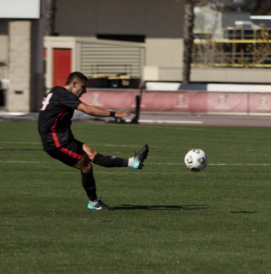 San Diego State men's soccer junior midfielder Tristan Weber scores off a free-kick to give San Diego State a 1-0 lead in the 24th minute. The Aztecs defeated No. 4 Washington 2-0 on March 28, 2021 at the SDSU Sports Deck.