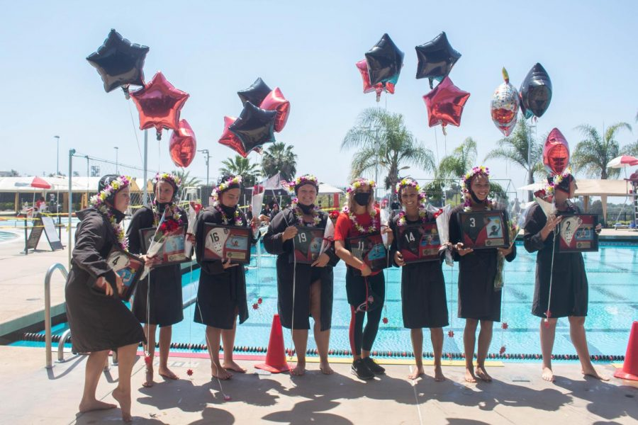 Eight seniors from the San Diego State water polo team pose for a photo during Senior Day festivities and before the Aztecs' 16-9 win over Cal Baptist on April 17, 2021 at the SDSU Aquaplex.