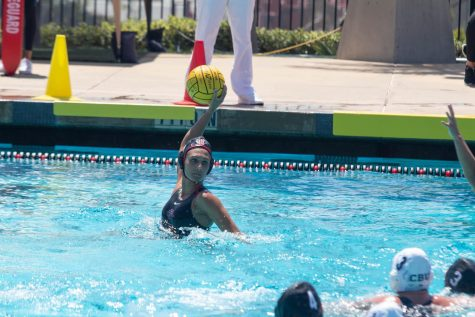 San Diego State water polo senior driver Karli Canale prepares to shoot during the Aztecs' 16-9 win over Cal Baptist on April 17, 2021 at the SDSU Aquaplex.