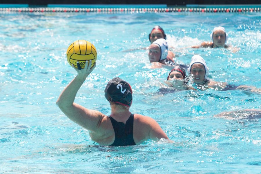 San Diego State water polo senior utility Emily Bennett prepares to shoot during the Aztecs' 16-9 win over Cal Baptist on April 17, 2021 at the SDSU Aquaplex.