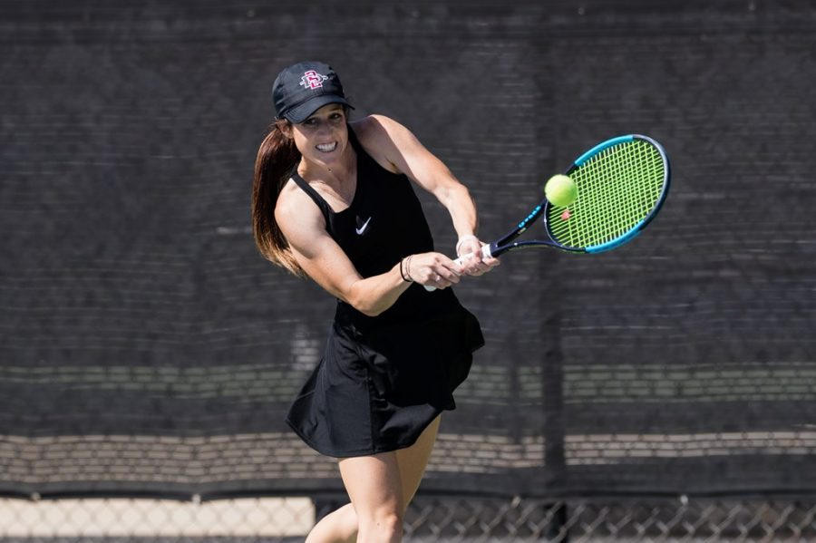 San Diego State women's tennis senior Abbie Mulbarger connects with the ball during the Aztecs' 7-0 loss to Oregon on March 22, 2021 at the SDSU Tennis Center.
