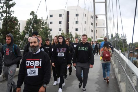 Rabbi Chalom Boudjnah marches with students for Holocaust Remembrance Day. This photo was taken before COVID-19.