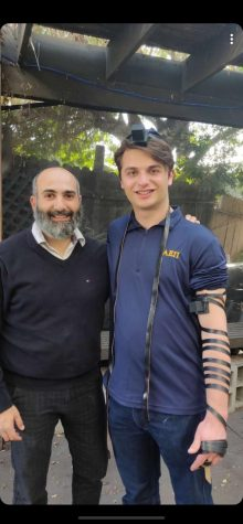 Rabbi Chalom Boudjnah stands next to the former president of AEPi, Ofek Suchard.