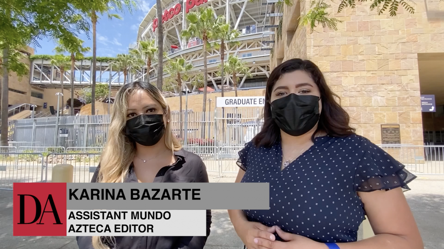Two reporters at 2021 commencement