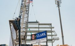 Steel workers insert the last beam into Aztec Stadium, completing the structural portion of the stadium.