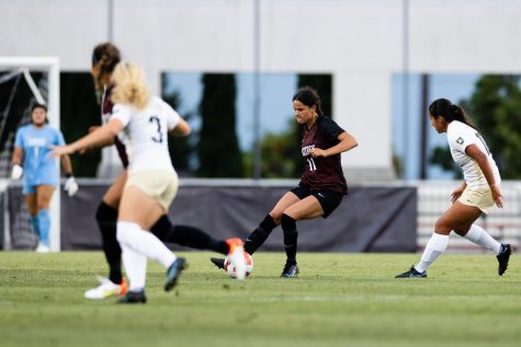 Denise Castro (11) fields the ball during a match against Army West Point (Courtesy of SDSU Athletics)