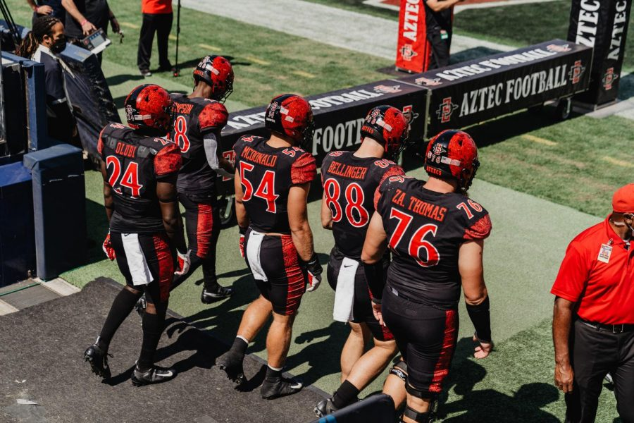 San Diego State football captains walk out before the game for the coin toss.