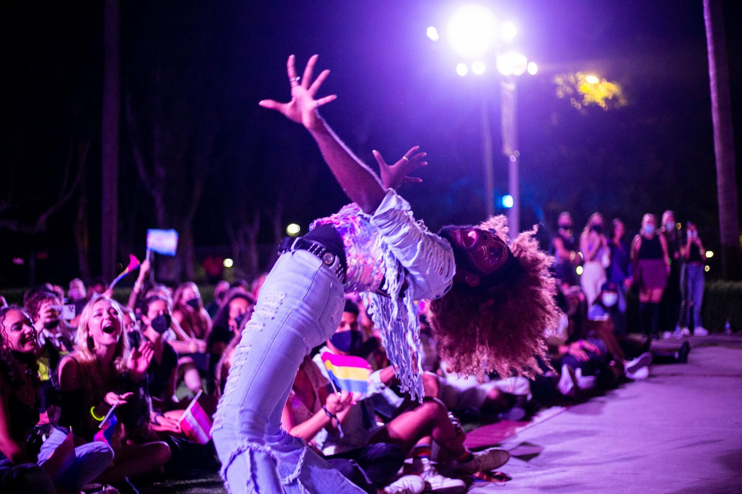 Amber St. James performing on stage in front of Hepner Hall during 2021 Dragstravaganza.