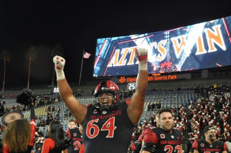 Senior lineman Chris Martinez revels in the moment after the triple overtime victory versus Utah. The Aztecs have defeated both of their Pac-12 opponents in 2021.