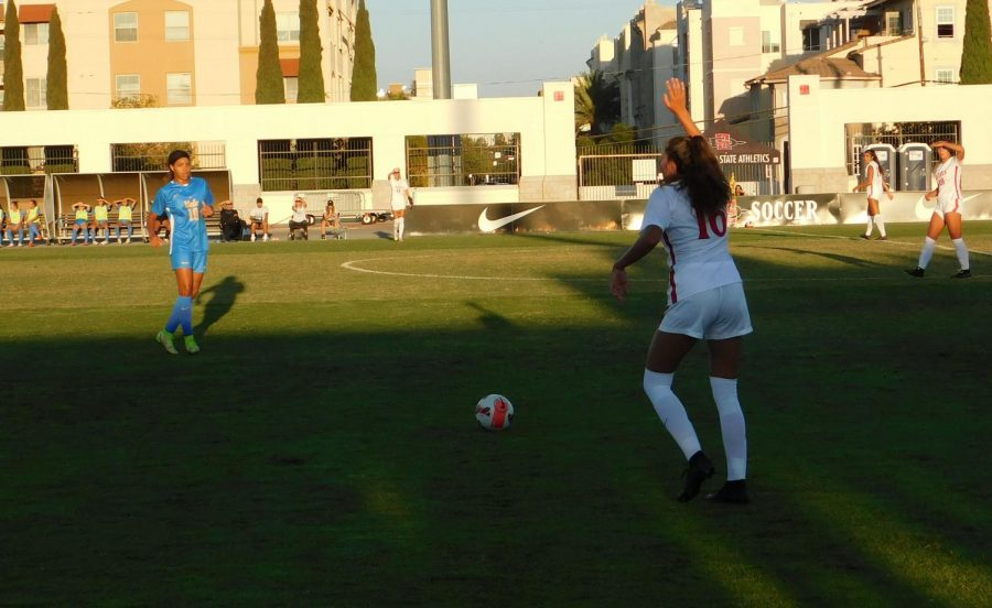 Junior+defender+Kiera+Utush+attempting+to+kick+the+ball+towards+her+teammates+early+in+the+first+half+against+UCLA.