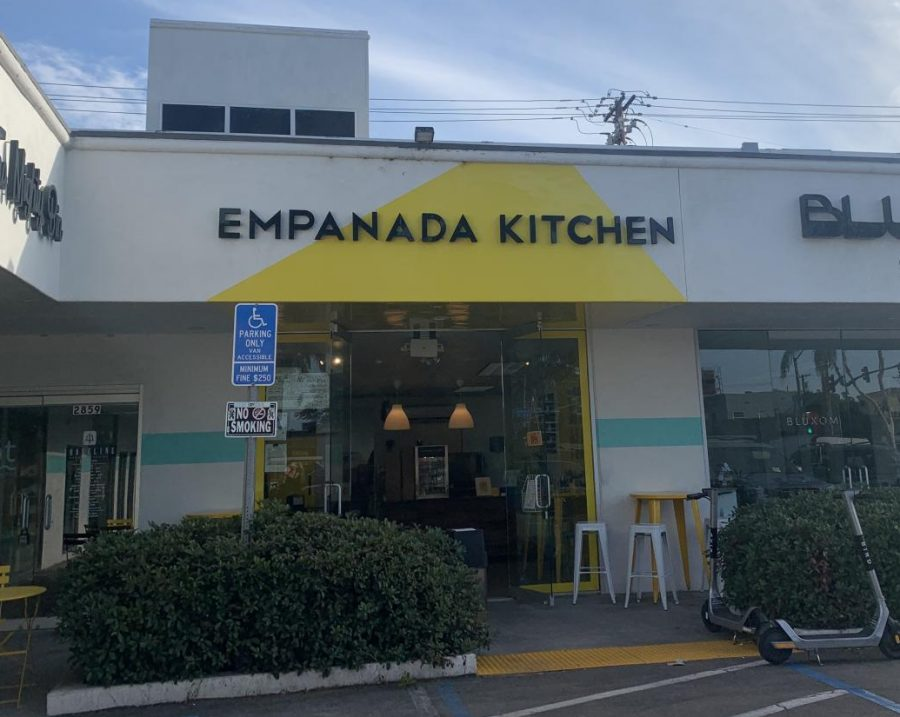 The+view+of+the+front+entrance+of+Empanada+Kitchen+before+one+enters+the+modern%2C+yet+tiny+store.+