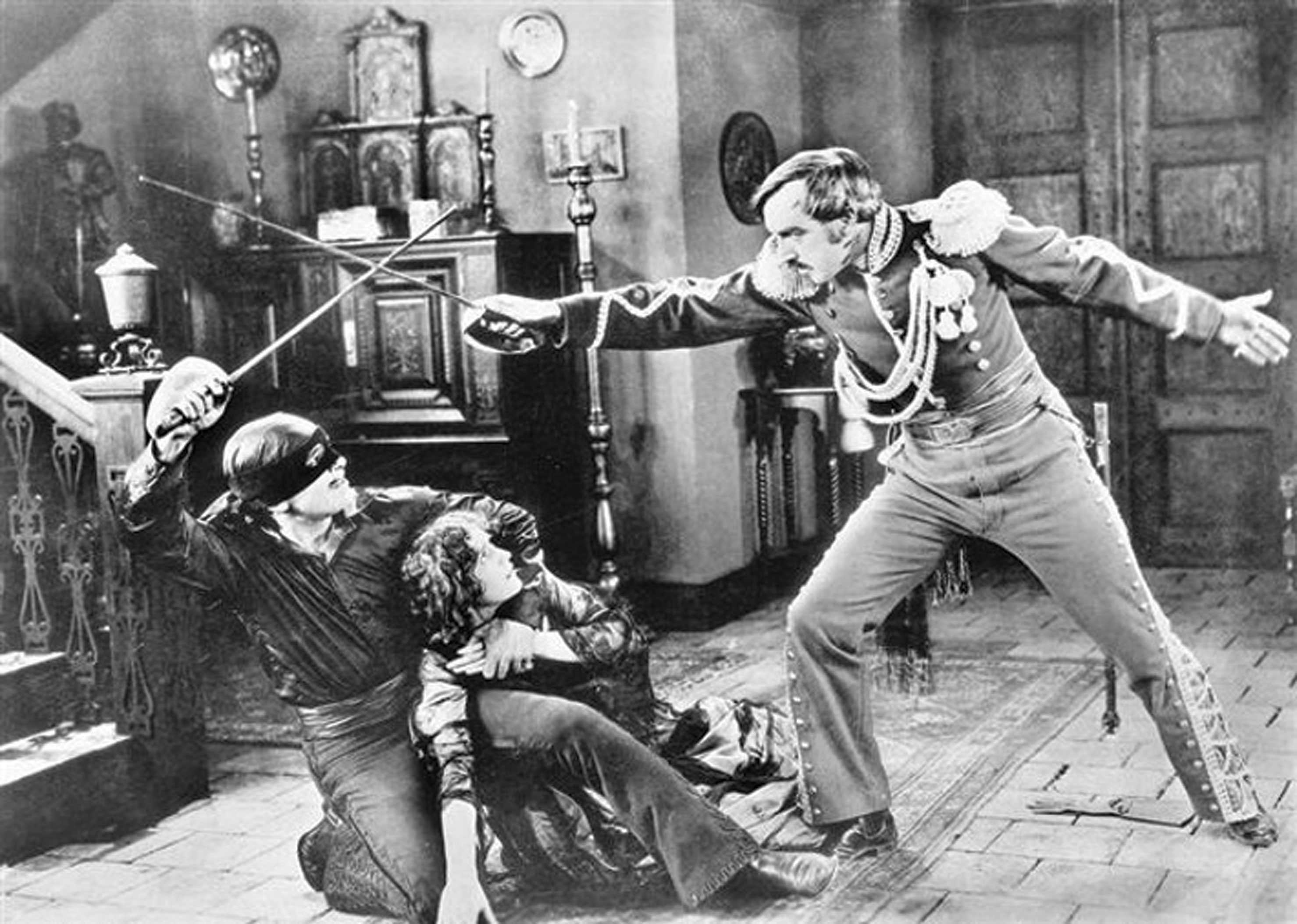 """Actors do battle in a still from the film """"The Mask of Zorro."""" 