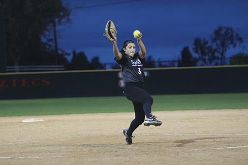 OToole pitches the softball.