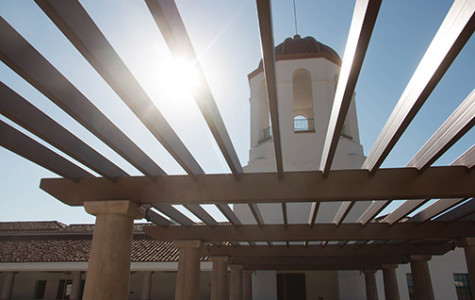 The sun shines through a natural shade covering of the Aztec student union.