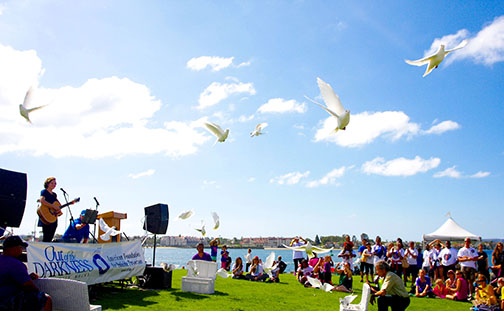A dove releasing ceremony was part of the days events. (Kalie Cristensen, staff photographer)