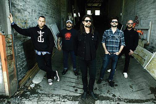 Alternative rock band reunites its full team for tour