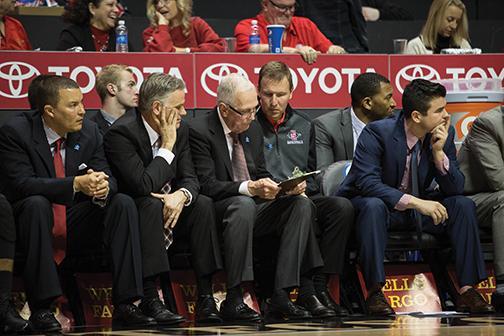 SDSU basketball coaches talk on bench