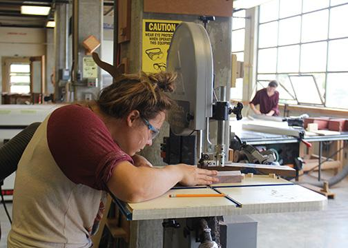 Students make furniture art with machinery