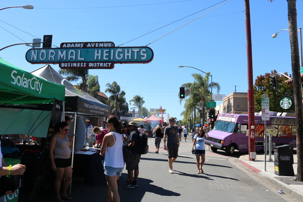 Festival goers browse the local vendors and food trucks.