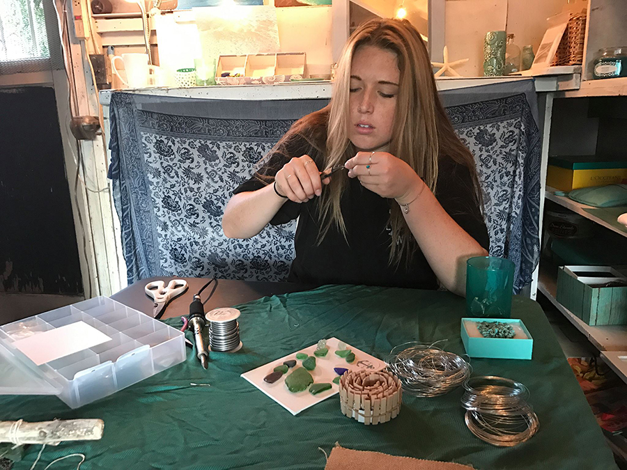 Danika Brown finds sea glass around San Diego and creates her own jewelry. Photo by Janelle Lafond