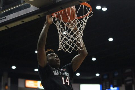 Redshirt sophomore forward Zylan Cheatham finishes a dunk in the Aztecs