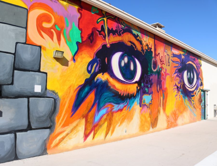 """This fiery mural located on the Art North building is definitely hard to miss. Paying homage to the murals in Chicano Park, Professor Mario Torero and his students debuted """"Eyes of Picasso"""" in December 2016. Other than the mural having a compelling backstory, it is sure to literally brighten up anyone's Instagram feed."""