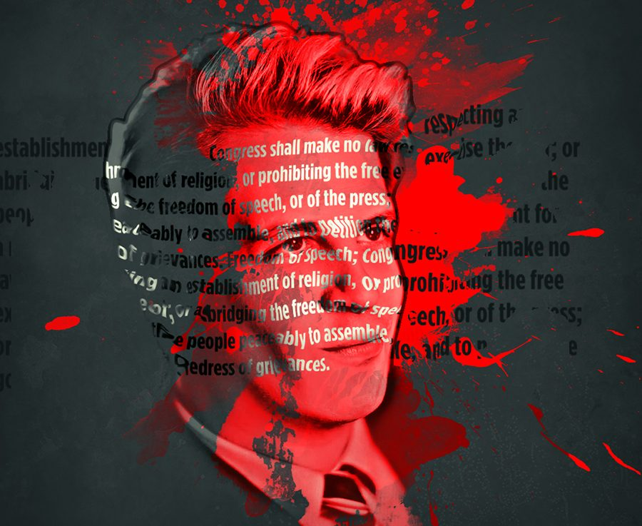 Milo Yinnopoulos' face with red spatter on a black background and the words of the first amendment reflected on his face.