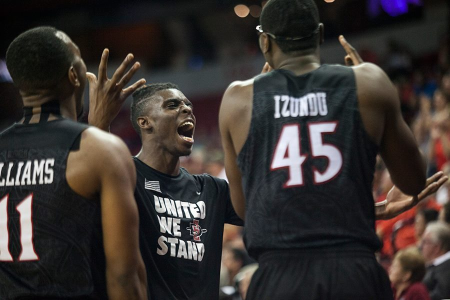 Junior forward Zylan Cheatham celebrates with senior guard D'erryl Williams and senior center Valentine Izundu.
