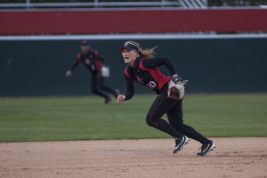 Freshman shortstop Shelby Thrompson reacts to a hit by a UCLA batter on Feb. 10.