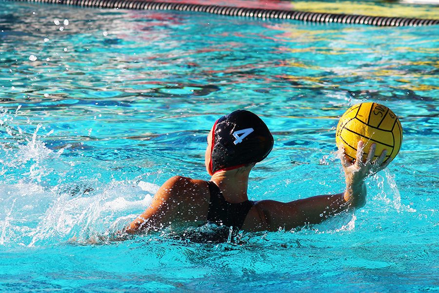 Senior utility Caroline Israels winds up for a throw down the pool.