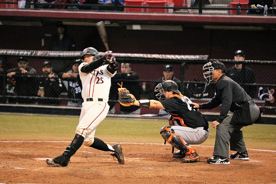 Sophomore catcher Dean Nevarez makes contact against a University of Pacific pitcher.
