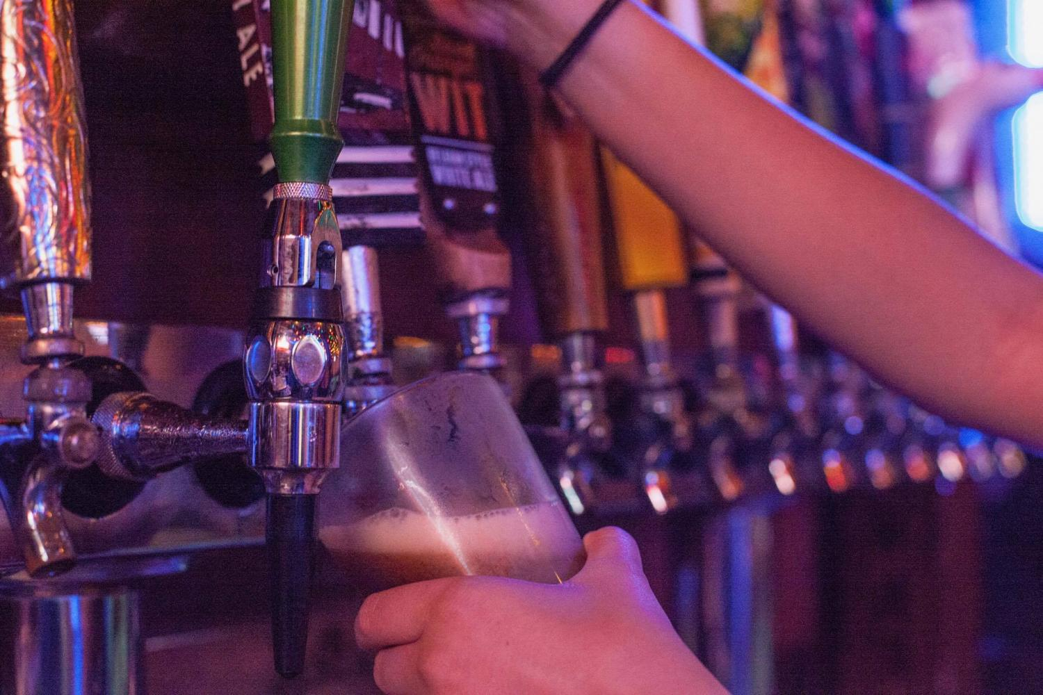 Marketing senior Lexi Price pours beer at Bubs in Pacific Beach.