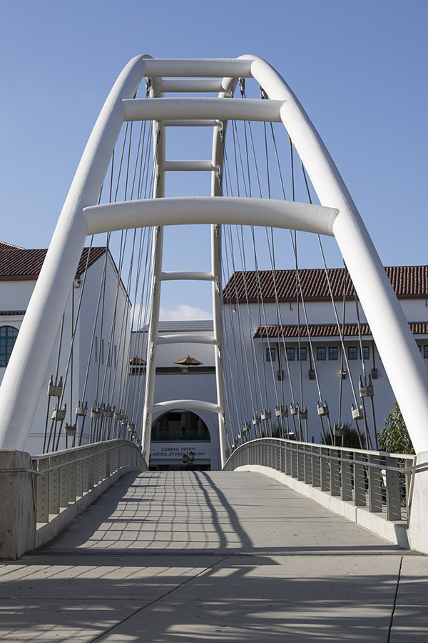 Frequently busy during the day, the pedestrian bridge connects many SDSU dorms to campus.