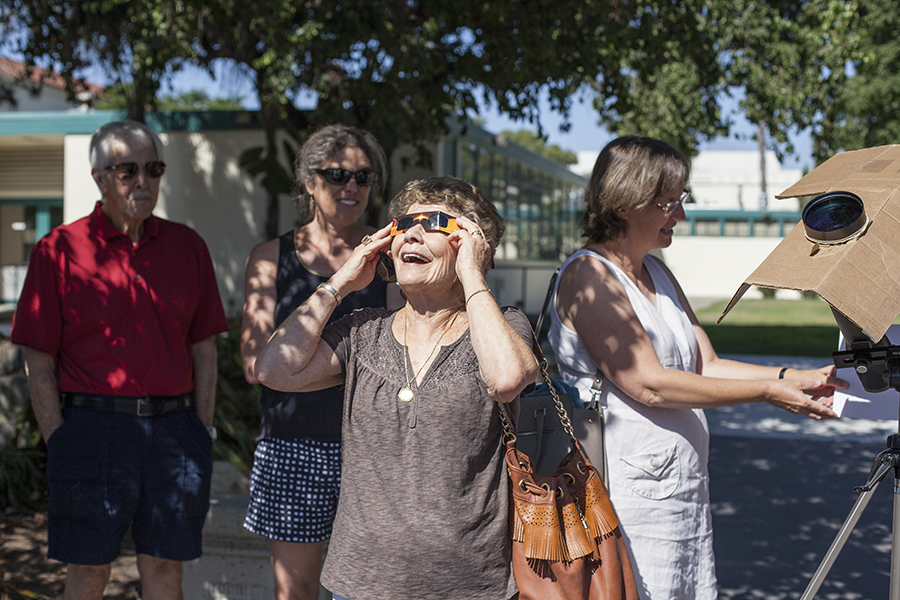 Susan Roch, mother of SDSU professor Marie Roch, views Monday's solar eclipse through special glasses