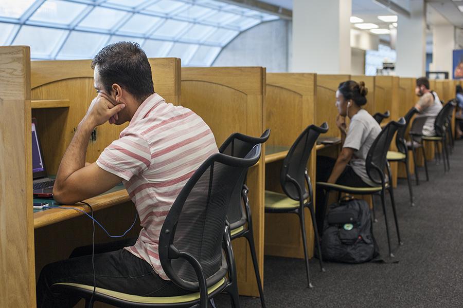 Anthropology senior Ricardo Betancourt studies in the library.