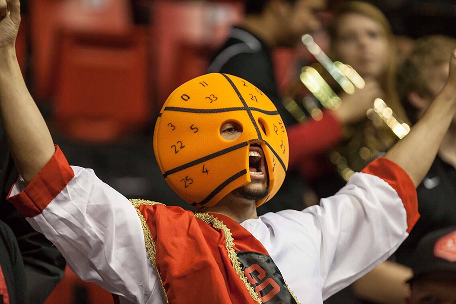 A member of The Show, SDSU's famed student section, cheers during a basketball game in the 2016-17 season.