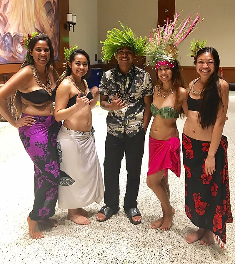 Antoinette Sharpe, Anuhea Tao Tufaga, Nash Salas, Tiffany Pascua and Myrna Gungon pose after performing a dance at last year's scholarship luau.
