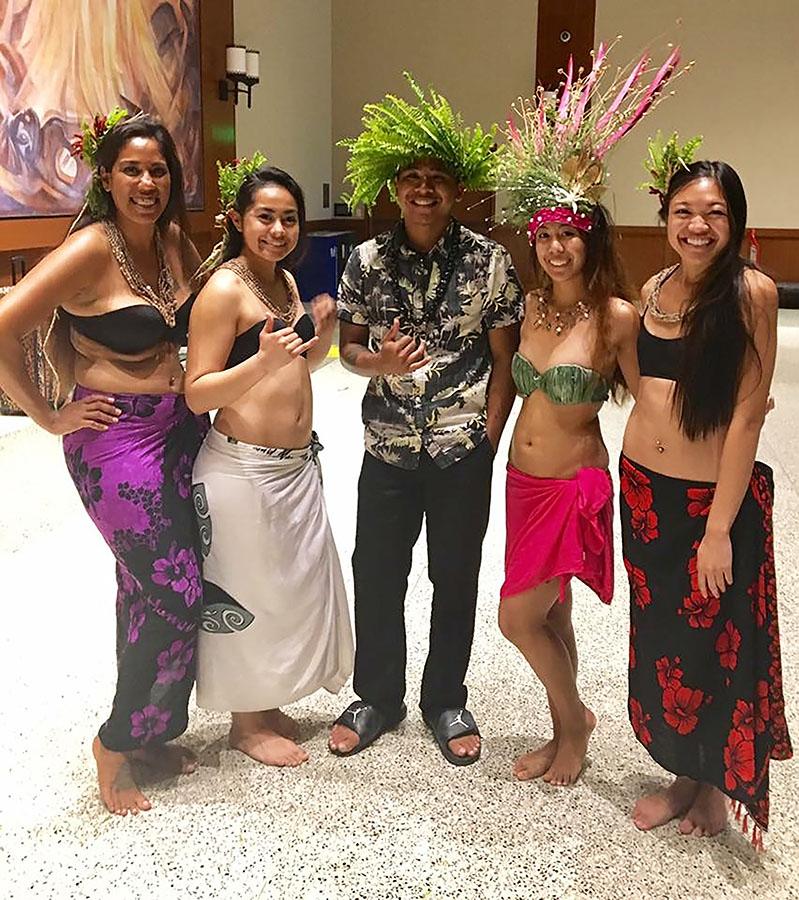 Antoinette Sharpe, Anuhea Tao Tufaga, Nash Salas, Tiffany Pascua and Myrna Gungon pose after performing a dance at last year's scholarship luau.